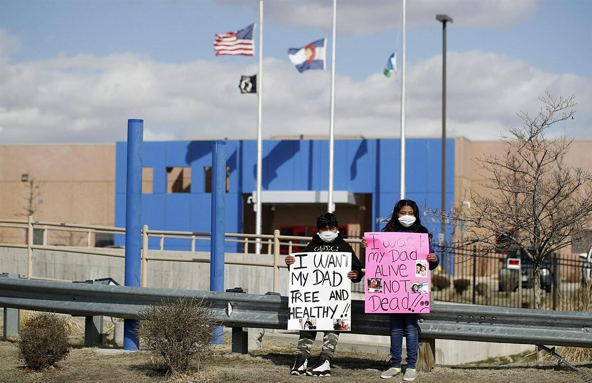 [Ca Children hold signs in protest with Abolish ICE Colorado outside the GEO Detention Center in Aurora on April 3, 2020.David Zalubowski / AP file